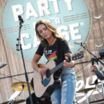 LAS VEGAS, NV - APRIL 01:  Musician Naomi Cooke of Runaway June performs onstage at the ACM Party For A Cause: Tailgate Party on April 1, 2017 in Las Vegas, Nevada.  (Photo by Rick Diamond/Getty Images for ACM)