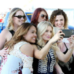LAS VEGAS, NV - APRIL 01:  Guests take selfies at the ACM Party For A Cause: Tailgate Party on April 1, 2017 in Las Vegas, Nevada.  (Photo by Gabe Ginsberg/Getty Images for ACM)