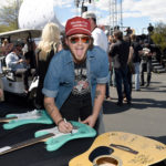 LAS VEGAS, NV - APRIL 01:  Singer Stephen Barker Liles signs a guitar at the ACM Party For A Cause: Tailgate Party on April 1, 2017 in Las Vegas, Nevada.  (Photo by Rick Diamond/Getty Images for ACM)