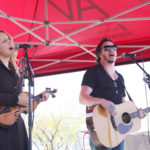 LAS VEGAS, NV - APRIL 01:  Musicians Jon Stone (L) and Kristy Osmunson of American Young perform onstage at the ACM Party For A Cause: Tailgate Party on April 1, 2017 in Las Vegas, Nevada.  (Photo by Gabe Ginsberg/Getty Images for ACM)