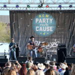 LAS VEGAS, NV - APRIL 01:  Singer Aaron Watson (C) performs onstage at the ACM Party For A Cause: Tailgate Party on April 1, 2017 in Las Vegas, Nevada.  (Photo by Gabe Ginsberg/Getty Images for ACM)